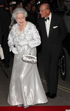 "Along with her main man Prince Phillip, the 86-year-old queen jaunted out for a gala performance of ""Our Extraordinary World"" at the Royal Opera House, suiting up in a rare evening look consisting of a shiny silver frock"