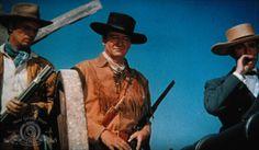 Richard Widmark, John Wayne, and Laurence Harvey