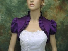 Purple short sleeve satin wedding bolero jacket shrug. $39.99, via Etsy.