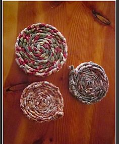 Use old shirts or leftover fabric to make these wonderful coasters.  Braid 1 1/2 inch strips and stitch them into flat circles.  The red and green ones come out at Christmas time.  You can also wash them but let air dry.