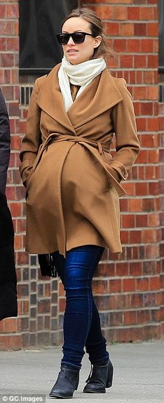 {What a great coat! Timeless and shapeshifting.} Maternity chic: Olivia Wilde dressed her very pregnant belly in a camel coat as she strolled around NYC on Monday.