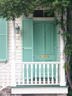 White house and railings, turquoise front door and shutters