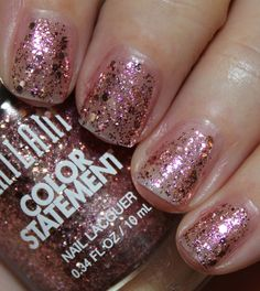 Milani Color Statement Nail Lacquer Club Lights.  Clear base with different size pink glitter.