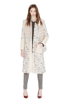 Fall 2013 Trend: Two Timing (Gretchen Jones' cotton, nylon, metallic and silk georgette vest over cotton, nylon and metallic coat with faux leather details. Tess Giberson's wool and acrylic sweater with waxed cotton stitching and leather leggings. Cédric Charlier shoes.)