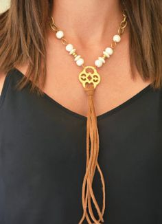 Gold Necklace with Bone Beads and Leather Tassel