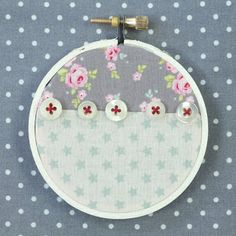 Inexpensive wooden embroidery hoops are great for simple wall art that can be made to coordinate with any decorating scheme; and the affordability