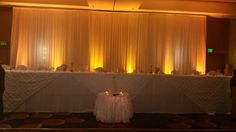 30 foot lighted backdrop with amber wireless uplighting