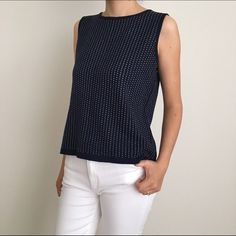 St. John Knits sleeveless top. Authentic St. John knits. Sleeveless knit top. Made in the USA. Size small. Wool/rayon. Navy blue. Excellent condition. Perfect for any occasion. Make an offer! St. John Tops Blouses