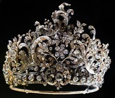 The Württemberg Rococo Tiara  This tiara was commissioned from court jeweler Eduard Foehr in 1896 by the future King Wilhelm II of Württemberg as a wedding present for his second wife, Princess Charlotte of Schaumburg-Lippe.  The tiara may be dismantled at whim and its sections be worn as brooches and hair ornaments.   It is currently kept and is on display in the Old Castle in Stuttgart, Baden-Württemberg.