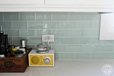 Kitchen Backsplash -Architectural Collections line called Cadence Collections in Seaglass in a 3×6 subway glass tile.