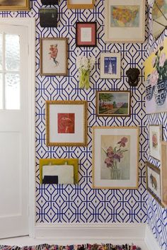 Bright patterned wallpaper with mixed frames.