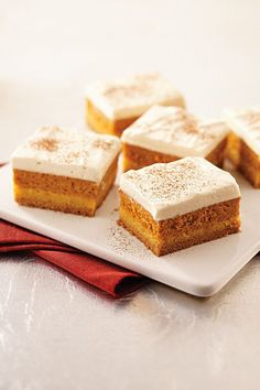Maple-Pumpkin Pie Bars -- Give 'em layers of dessert recipe yumminess--from a buttery cake crust to a luscious pumpkin pie filling to a sweet and creamy maple-whipped topping.