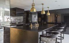 Ultra luxurious dark kitchen by James Dixon Architect PC - Bond Street Apartment, New York
