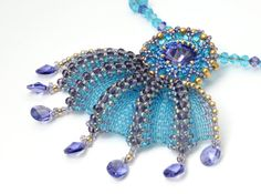Tanzanite Wave EBWC Am I Blue Embroidered Crystal Pendant by DDeli, $60.00