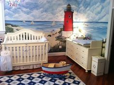 nautical baby nursery   Nautical-themed nursery with lighthouse mural. Image from here .