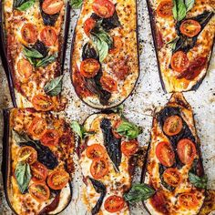 EGGPLANT PIZZA . 2 large eggplants, sliced 1 inch thick 24 oz jar tomato sauce 20 slices provolone cheese 3-4 oz fresh cherry tomatoes, sliced 1 cup fresh spinach or basil 1/2 tsp himalayan salt Pepper flakes . Preheat your oven to 425 F. In two baking trays arrange the sliced eggplants. Sprinkle the Himalayan salt and bake for 15-20 minutes.  Remove the bake eggplant from the oven and turn your broiler on. Spread 1 tablespoon of tomato s