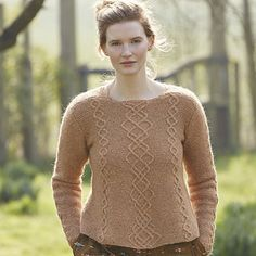 'Jasmine' is a flattering design to wear. It is slightly A line in shape and the saddle shoulders allow the cable pattern to extend up to the side of the neck. It is knitted with a combination of garter stitch and cables and therefore is a good practise style for those wishing to improve their cabling skills.