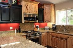 Scott River Custom Cabinets: Raised Panel Rustic Hickory & Painted Black Cabinets--perfect set up for our kitchen.