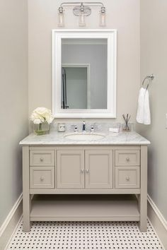 Hung from a light gray wall, a white beveled vanity mirror is mounted over a light taupe bath vanity boasting a chrome faucet kit fixed to a gray marble countertop. Gray Bathroom Walls, White Bathroom Paint, Bathroom Kids, Neutral Bathroom, Bathrooms, Taupe Walls, Light Grey Walls, Transitional Bathroom, Custom Built Homes