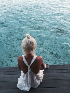 white dress. top knot. blue water.