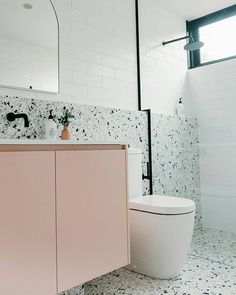terrazo flooring Theres a lot to love in this Port Fairy project - from the practicality of the terrazzo tile half wall, millennial pink vanity for a pop Reece Bathroom, Laundry In Bathroom, Small Bathroom, Pink Bathroom Tiles, Light Bathroom, Modern Bathroom, Bathroom Ideas, Terrazo Flooring, Pink Toilet