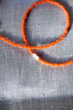 Orange glass bead necklace . Two Cream faceted glass bead accent . Minimalistic . Simple.