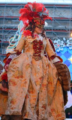 https://flic.kr/p/7VN2Lz   Costume contest at the 2010 Carnevale in Venice (IMG_9909a)   I was in San Marco Piazza in Venice during the 2010 Carnevale in mid-February when I learned there was going to be a contest for the best costumes. I was in a prime location so I hung around despite being packed in the crowd like a sardine.  This was actually tough to shoot since it started at 4 p.m. and I had to shoot directly into the setting sun and bright stage lights so I had to time it waiting for…