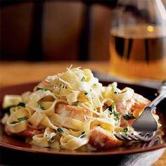 Seafood Fettuccine Recipe Main Dishes with butter, green onions, garlic cloves, medium shrimp, sea scallops, half & half, salt, black pepper, lump crab meat, fresh parmesan cheese, fettucine, fresh parsley