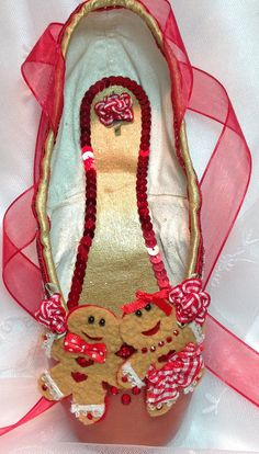 Nutcracker ginger cookie decorated pointe shoe. by DesignsEnPointe