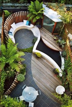 curved seating around a tree in corner of garden - Google Search