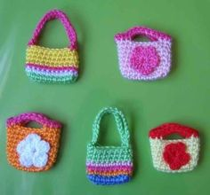 Patterns in PDF -- a set of 2 hand crocheted purse bag patterns for American girl and Gotz or Blythe or similar 18 inches dolls. $6.99, via Etsy.