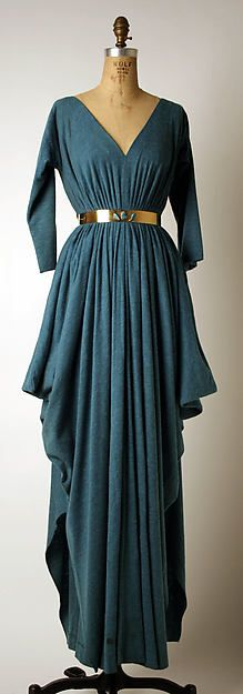 Evening dress Designer: Madame Grès (Alix Barton) (French, Paris 1903–1993 Var region) Date: late 1960s–mid-1980s Culture: French Medium: (a) wool (b) wool, brass Dimensions: (a) L. at center back 61 in. (152.3 cm) (b) L. 26 ½ in. (67.3 cm) Credit Line: Gift of Chessy Rayner, 1997