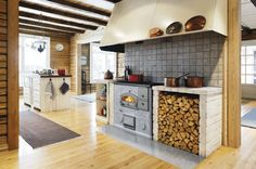 If we ever build another log home this will be my stove.  Our tuli fireplace is the focal point of our great room.