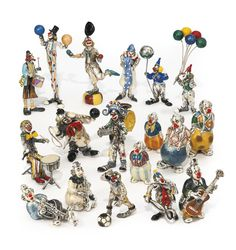 A group of Italian silver and enamel clowns, Sorini and Saturno, Arezzo, late 20th / early 21st century
