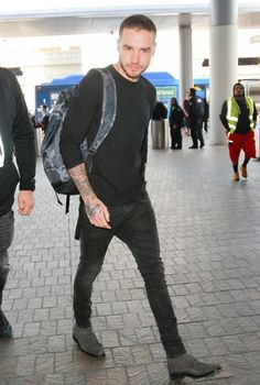 'One Direction' singer Liam Payne was spotted departing from LAX airport in Los Angeles, California on January 15, 2016. Liam shows off his new haircut where he had his head shaved.