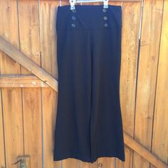 High-waisted Sailor Slacks Madd Apparel • six buttons, plus one extra • size 13 • side hip zip • no pockets • excellent condition • hugs the hips and bum, very loose in the legs • looks great with flats or heels • made in Canada Madd Apparel Pants
