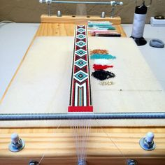 Here's the hatband on the loom. I make these on our special designed handmade solid wood bead looms, also available in either of our Etsy shops. (See PuebloBeadAndSupply for more! Beaded Bracelet Patterns, Beading Patterns, Friendship Bracelet Patterns, Native Beadwork, Native American Beadwork, Tear, Beaded Ornaments, Beading Projects, Loom Weaving