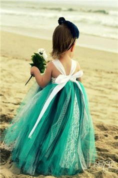 Adorable flower girl dress in perfect colors for a beach wedding. If you want the best officiant for your Outer Banks, NC, ceremony, contact Rev. Barbara Mulford: myobxofficiant.com/