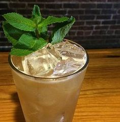 2 oz High West Double Rye  1.5 oz ice tea  1 oz lemonade 1 oz unfiltered Apple Juice 4-5 mint leaves  Combine all ingredients and shake hard! Strain it all out into a pint glass with fresh ice (to keep it colder longer) and garnish with a mint sprig dipped in powdered sugar!