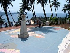 The equator marked as it crosses Ilhéu das Rolas, in São Tomé and Príncipe. The shadow points SW, indicating that the Sun is several degrees North; likely late April or early August, about 1-2 hours before Noon.