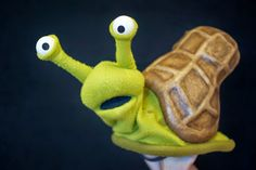 Gail the Peanut Snail  fleece, papier-mache, misc.   This is a puppet I made for a friend of mine, Bryan Seastrom. He asked for a snai...
