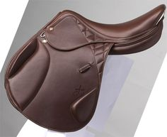 Prestige DX Monoflap Eventing Saddle :  Calfskin saddle from Prestige : . The monoflap style allow the closest contact possible between horse and rider while the knee and thigh blocks will keep you secure in the saddle.