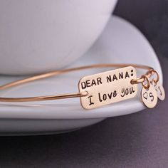 Mother's Day Gift for Nana, Dear Nana, I Love You Bracelet, Personalized Mother's Day Jewelry for Grandma, Bangle Bracelet by georgiedesigns on Etsy https://www.etsy.com/listing/230762470/mothers-day-gift-for-nana-dear-nana-i
