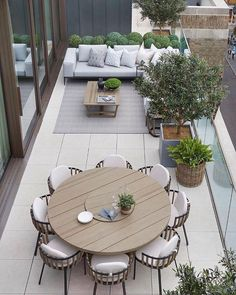 The penthouse terrace we have dressed with contemporary furniture and outdoor fabrics and all faux planting. Faux buxus balls by… Rooftop Terrace Design, Terrace Decor, Terrace Garden Design, Outdoor Rooms, Outdoor Living, Outdoor Decor, Backyard Patio Designs, Backyard Ideas, Garden Ideas