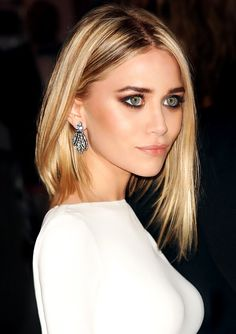 ashley olsen: asymetrical cut with jagged edges, matte brown smokey eye, white straight neck dress