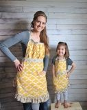 Special memories are created in the kitchen when you cook with your kids. Make those memories extra special by wearing matching Mommy and Me aprons. Protect her clothes and yours, for those spontaneous moments when the kitchen aid mixer gets turn on high and everyone and everything gets dusted with flour.