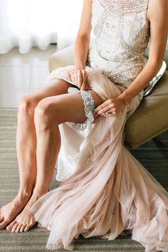 Brogen Jessup Photography   Garter for a bride on her wedding day under a dress