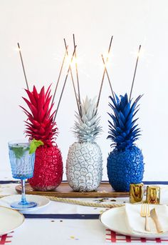 Have some fun with your table settings with fruity lighters, turning pineapples into playful and patriotic statement pieces.