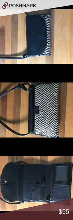 Fossil Sophia Wallet Crossbody NWOT Black leather with detachable crossbody strap.  Can be carried as a regular wallet in a purse or as a clutch. Has pockets that fit phone, lipstick, and gum. Never been carried. New without tag. Fossil Bags Crossbody Bags
