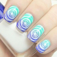 This water marble nail art design is very creative in making white swirling patterns on top a gradient base color.